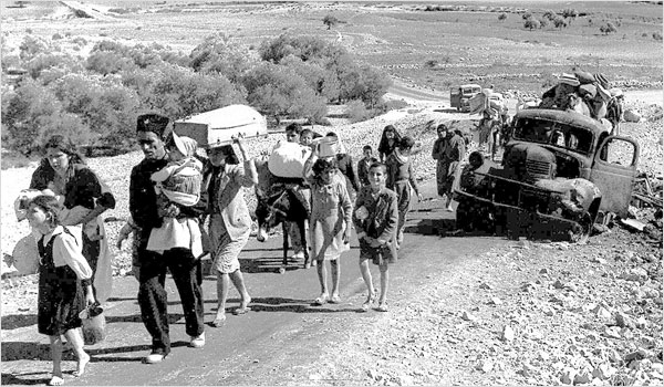 Palestinian refugees in 1948. By: Fred Csasznik