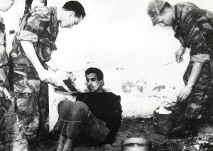 French paratroopers torturing a prisoner from the Algerian Liberation Front. Image; Saber68