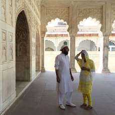 """Agra Fort - I photographed this Muslim couple on their honeymoon. People are happy to be photographed in India and more-so love to be photographed with you! It was this reverse orientalism where the fair skinned Westerner was the subject of curiosity and awe, but, heck, you must say """"yes!"""" when a whole bunch of sweet aunties want you in their photo! I had little girls wanting photos with me and asking me to pose like them."""