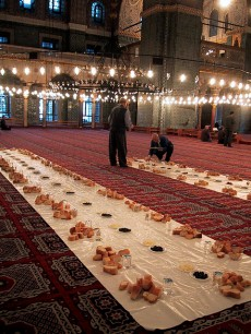 A communal iftar is set up in an Istanbul mosque. By: Balavenise.