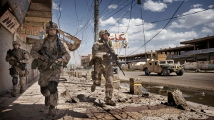 U.S. Marines from the 3rd Battalion, 8th Marine Regiment, Kilo company scan streets and surrounding buildings for insurgents during a patrol in Ramadi, 115 kilometers west of Baghdad. By: Yuri Kosyrev