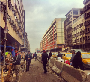 Road blocks divide Al Jamhouriya St, Baghdad (2012).