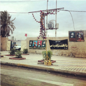 Street signs, which depict images of holy persons in Islam, litter the streets of Baghdad (2012).