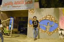 Hasanin, next to his wall art at the entry of the Art Palace. Image: Hawraa Adnan.